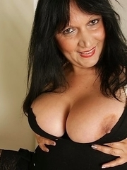 Chubby mama with big tits getting frisky