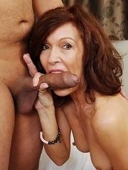 Horny cougar sucking a big hard cock