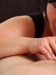 Big breasted mature slut sucking a hard cock