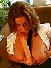 This naughty mama loves getting wet on the couch