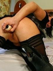 Masked mature slut riding on her dildo