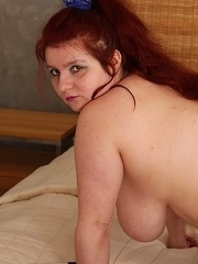 Big breasted mature slut going wild and beyond